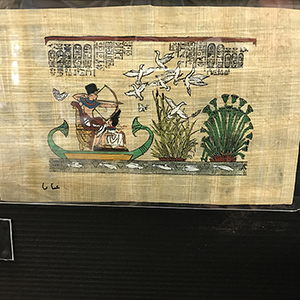 Colourful ancient Egyptian scene on a rough ancient papyrus leaf