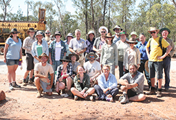Group of 24 staff and students at dig site