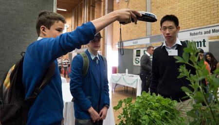 School students using scanning equipment