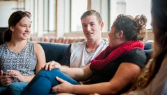 Students in conversation in common room