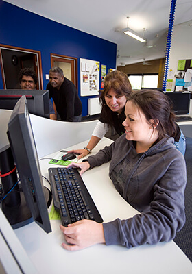 Oorala staff member helping a student in the computer lab