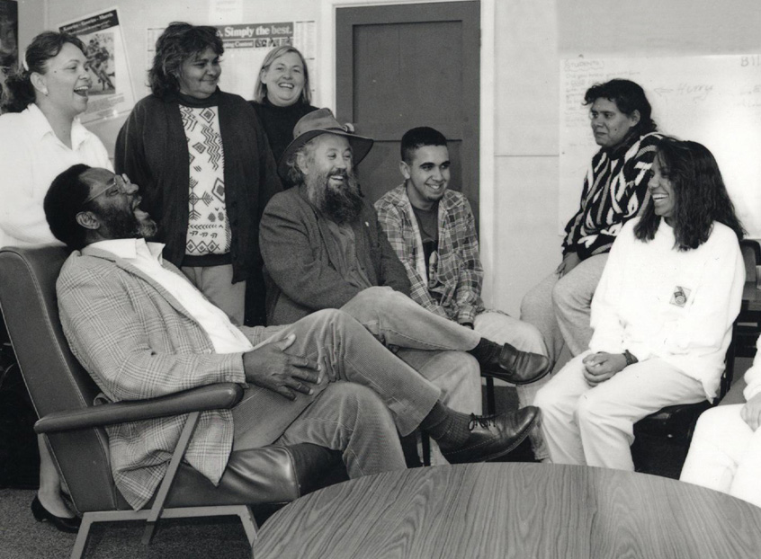 1994 Bill Oates laughing with other staff
