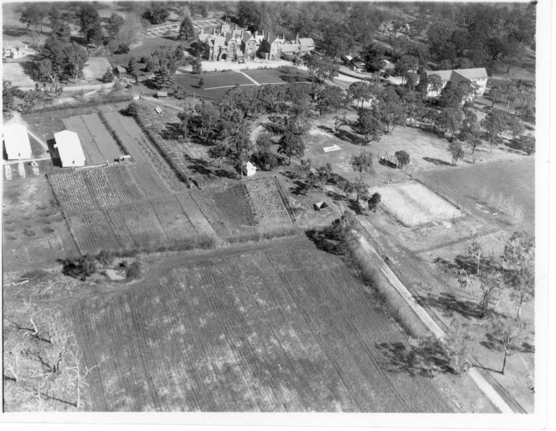 Black and white aerial photo from 1952 of the grounds around Booloominbah