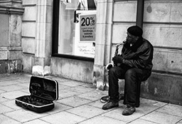 Man busking with saxophone