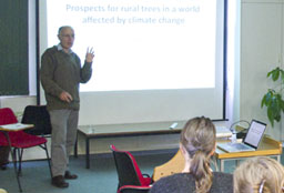 Man presenting a research seminar