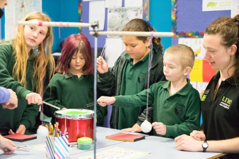 Primary School aged children performing science experiments with UNE Discovery