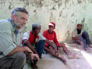 Dr Mark Moore and local Ngada villagers at the fossil site, Mata Menge, photo by Yinika Perston
