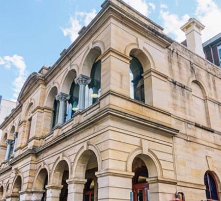 Sandstone facade of UNE Sydney in Parramatta.