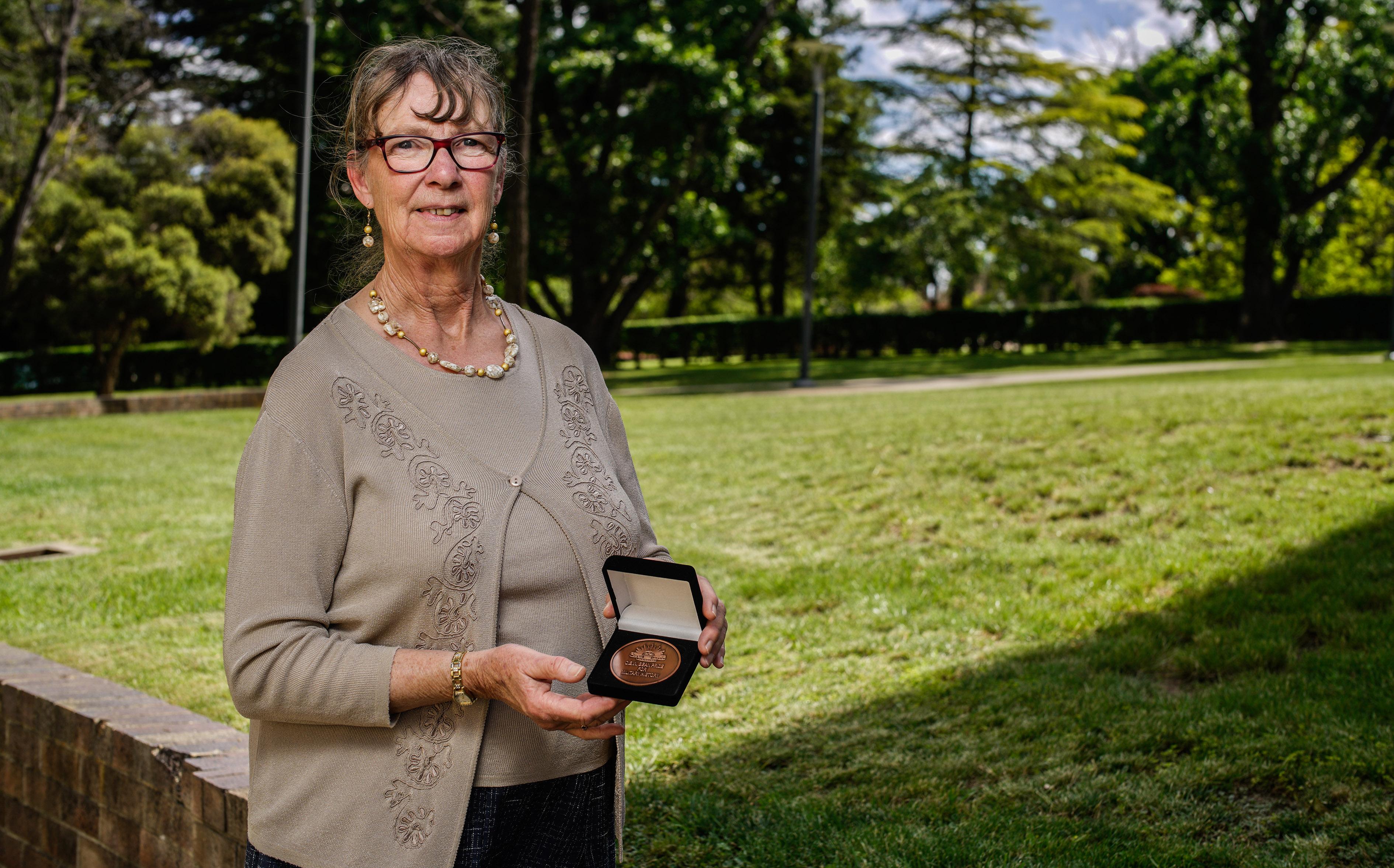 Anneke van Mosseveld holding a medal