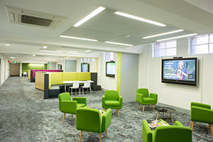 Breakout spaces with lounges, wall mounted screens and retractable whiteboard walls