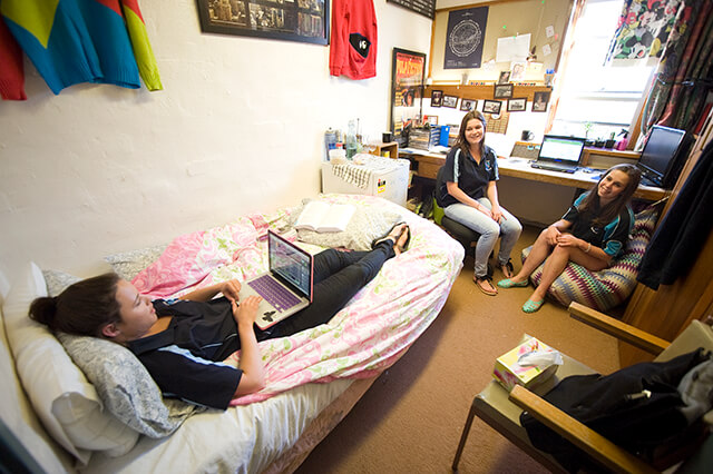 Three female students lazing around in a Duval room