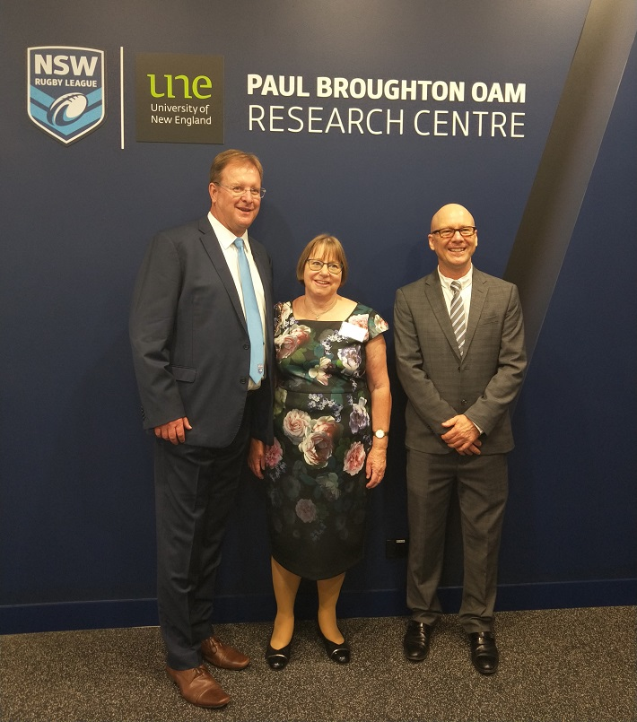 David Trodden, Annabelle Duncan, and Robert Field standing in front of Paul Boughton OAM Research Centre signage