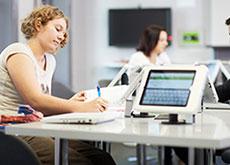 Three students using an iPad bank at UNE Future Campus Parramatta