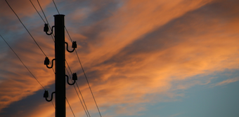 Sunset sky with phone lines in forground