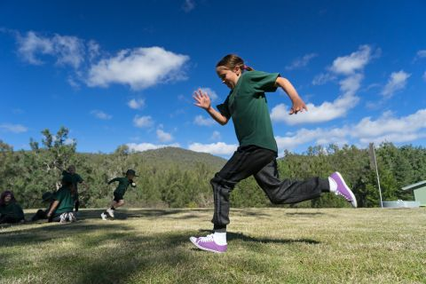 Child running as part of the UNE Discovery Sports and Exercise science learning activity.