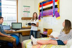 Three students in Duval college room