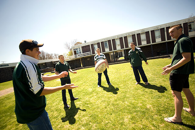 A casual game of footy on Robb College lawn