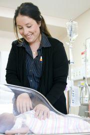 Nursing student checking an infant patient
