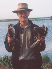 holding a pair of birds