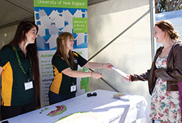 Handing out information about accommodation at UNE Open Day