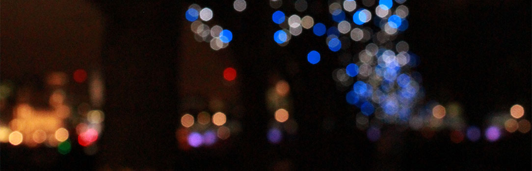 Blurred image of multi coloured lights on dark background