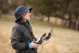 Woman with drone control.
