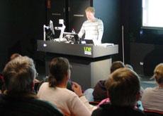 Seminar presenter addressing audience