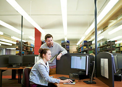 Two students using computer in Dixson Library