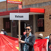 Vietnames student marching in the Armidale Autumn Festival Parade