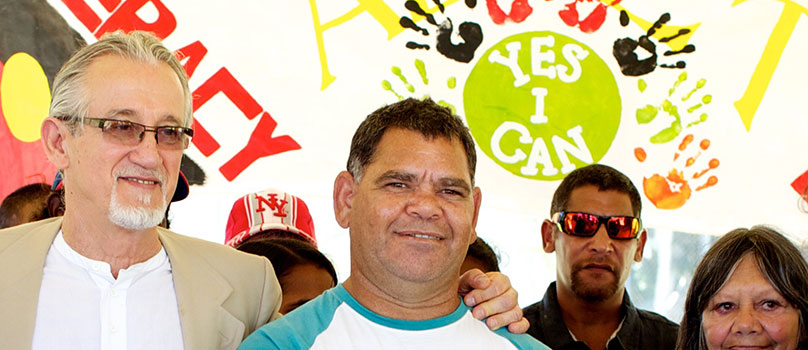 Aboriginal man with certificate of completion for his literacy course.