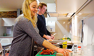 College residents using communal kitchen