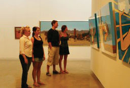 Students viewing art on display at NERAM